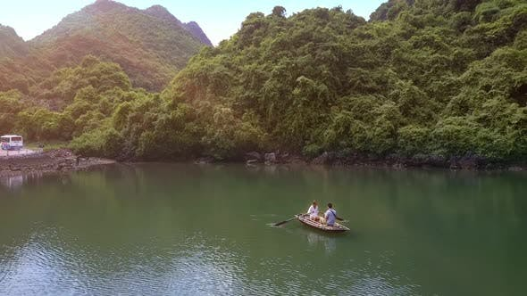 Thumbnail for Drone Removes From Man Sailing on Boat with Girl in Bay Ha Long