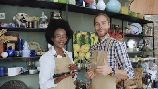 Thumbnail for Mixed Race Sellers which Standing in front of Camera in Cozy Gift Shop