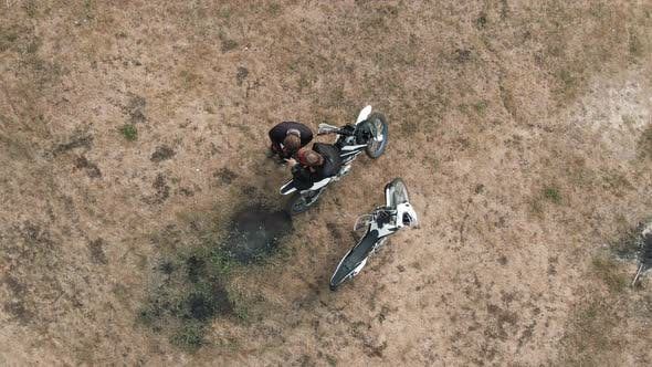 Thumbnail for Aerial Shot of Motorcyclists Using Mobile Phone