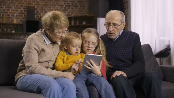 Thumbnail for Family Using Tablet Pc on Sofa Together at Home