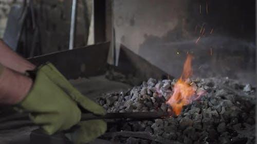Blacksmith Annealing Iron Ingot in Stove