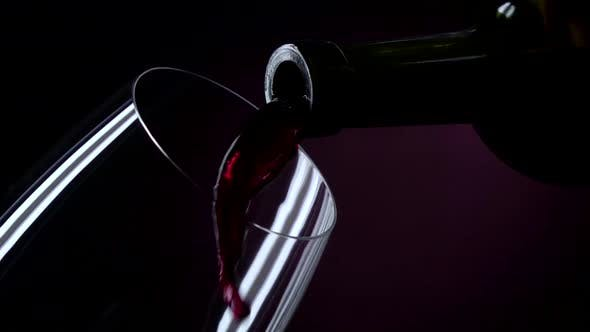 Thumbnail for The Bottle of Wine, the Wine Is Poured Into a Glass, Black, Closeup, Slowmotion