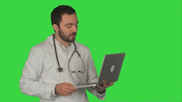Thumbnail for Doctor Having Video Conference on Laptop With Patient on a Green Screen, Chroma Key
