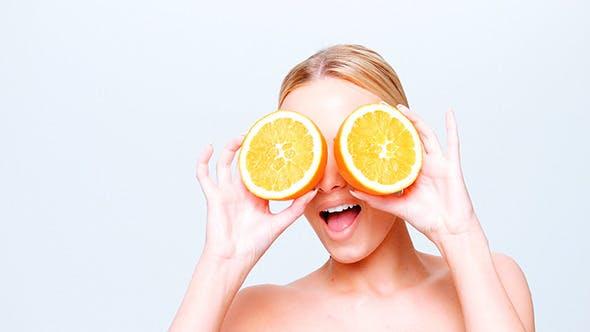 Thumbnail for Cute Blond Girl Holding Orange Fruit