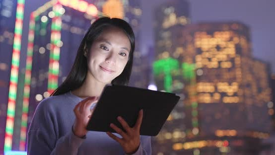 Thumbnail for Woman use of digital tablet computer at night