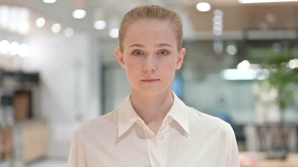 Cover Image for Portrait of Serious Young Businesswoman Looking at Camera