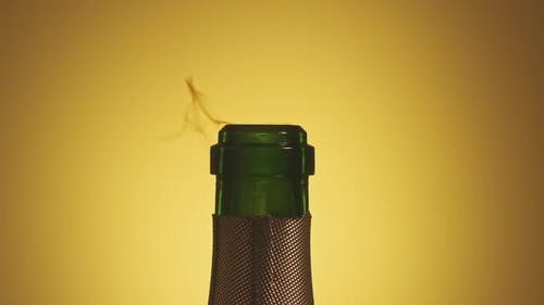 Opening Bottle of Champagne Wine. Champagne Explosion with Flying Cork