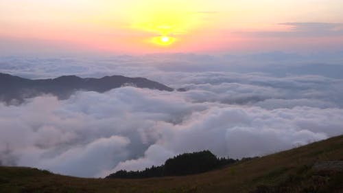 Morning in Mountain Meadows and Sunrise Over the Clouds