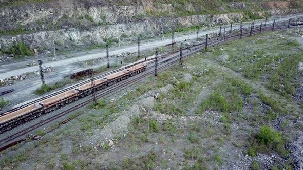 Thumbnail for Diesel Locomotive Is Pushing Dump Car Filled