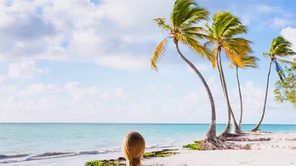 Thumbnail for Woman meditating on beach