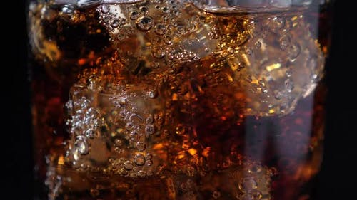 Fizzling Cola in the Glass
