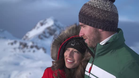 Thumbnail for A man and woman couple lifestyle in the snow at a ski resort