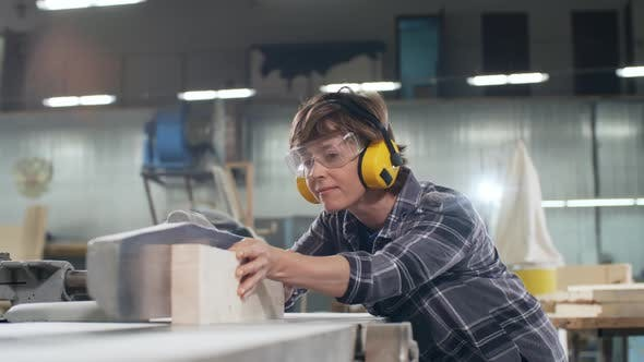 Thumbnail for Female Carpenter Sawing Wood