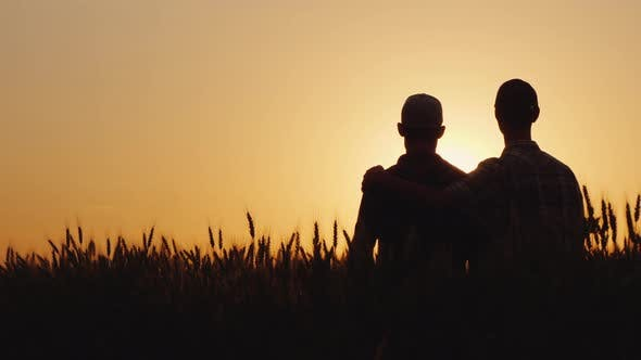 Thumbnail for Two Gay Men Stand Hugging at Sunset