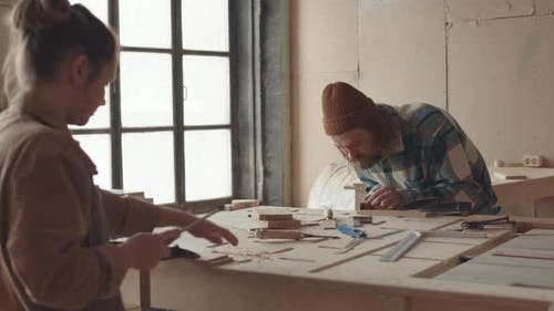 Pair of Joiners Working in Carpentry Workshop