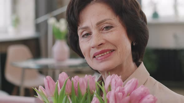 Attractive Senior Woman With Tulips