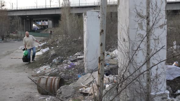 Thumbnail for Man Looking for Plastic at Garbage Dump in City