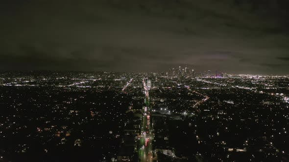 Thumbnail for View Over Los Angeles at Night with Wilshire Boulevard Glowing Streets and City Car Traffic