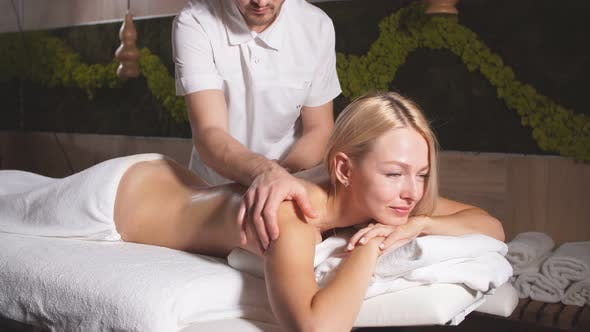 Charming Young Blonde Lady Having Aromatherapy Massage with Essential Oil