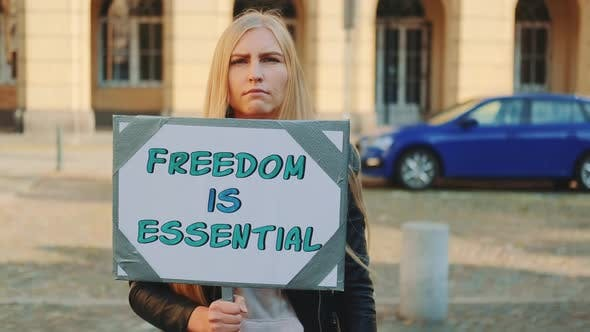 Woman on Protest Walk Calling That Freedom is Essential