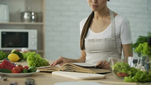 Thumbnail for Asian Woman Reading Cooking Book and Choosing Salad Recipe Healthy Food