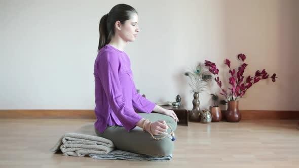 Thumbnail for Women meditating cross legged