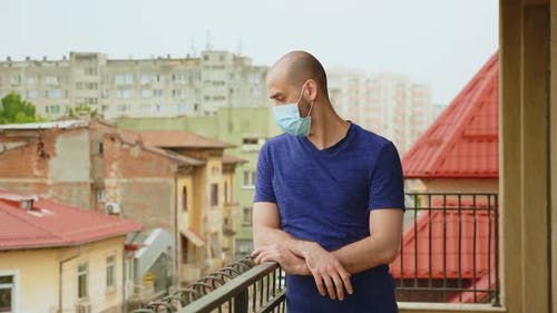 Anxious Man with Mask on Terrace