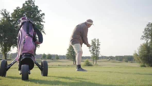 Thumbnail for Mature Man Playing Golf on the Golf Field