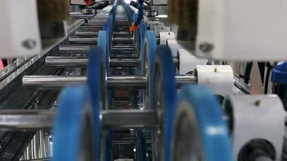 Thumbnail for Bewegliche Teile des Förderers in der Produktion