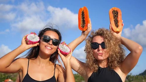 Summer Girls Dancing With Fruits On Vacation on Beach