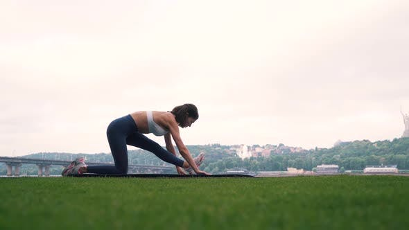 Thumbnail for the Girl Is Engaged in Fitness on the Background of the City