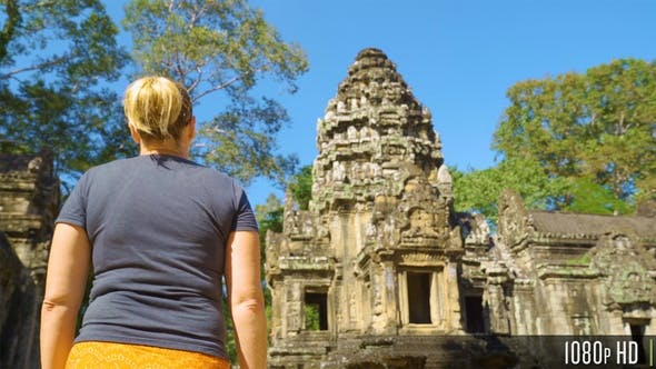 Following Back of Woman Walking to Thommanon Temple in Siem Reap, Cambodia