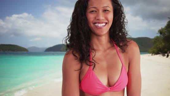 Mixed race woman smiling at the beach having fun