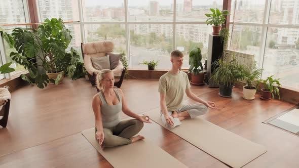 Couple Meditating In Lotus Pose