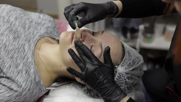 Cosmetologist Applies Peeling Lotion on Woman Face in Beauty Clinic Salon