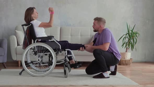 Thumbnail for A young man and his disabled wife