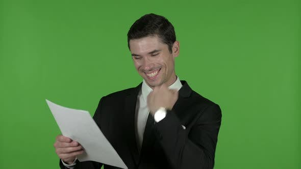 Thumbnail for Excited Young Businessman Reading Documents, Chroma Key