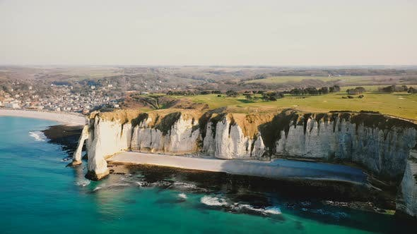 Cover Image for Drone Is Slowly Panning Right Above Breathtaking White Cliffs Near Idyllic Sunset Seaside Town