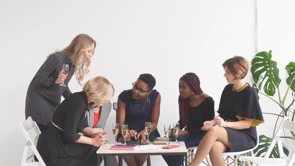 Thumbnail for Happy Business Ladies Celebrate with Champagne at Office Meeting