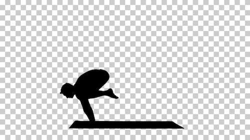 Silhouette Handsome man doing yoga asanas.