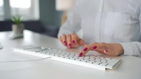 Woman Typing on a Computer Keyboard