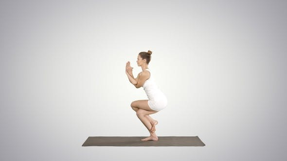 Thumbnail for Beautiful young woman doing yoga exercise for ankles calves,