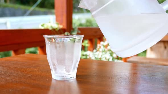 Thumbnail for Pouring iced water in glass