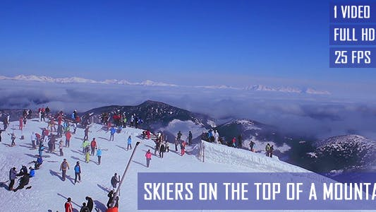 Thumbnail for Skiers On The Top Of A Mountain