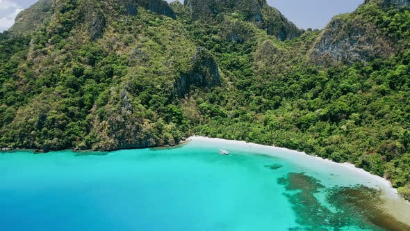 Thumbnail for Aerial Footage of Empty Tropical Beach and Amazing Blue Bay Cadlao Lagoon. El-Nido. Palawan