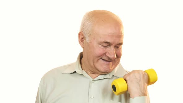 Thumbnail for Happy Old Man Showing Thumbs Up Working Out with a Dumbbell