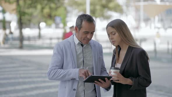 Thumbnail for Happy Male and Female Colleagues Using Tablet Pc Outdoor
