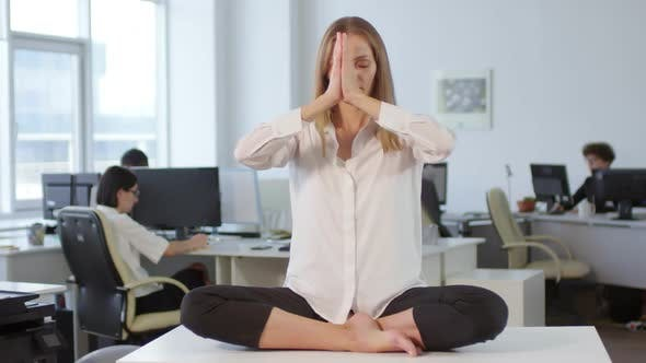Cover Image for Female Office Worker Meditating