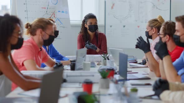 Masked People Talking Office