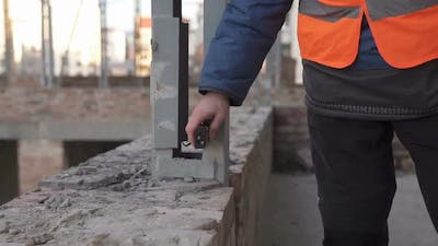 Measurements of buildings with a laser tape measure